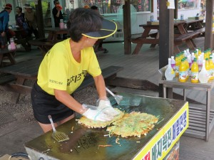 Making pancakes outside the Temple